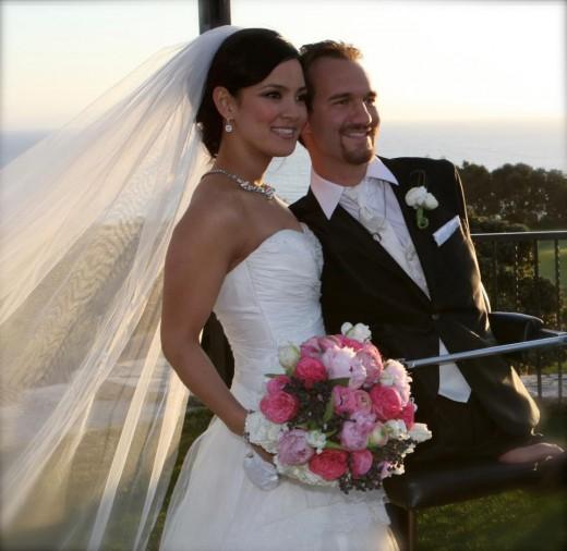 Ник Вуйчич с женой Канаэ